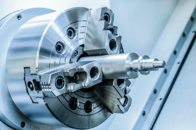 metal-workpiece-clamped-in-the-lathe-chuck-cnc-machine.jpg