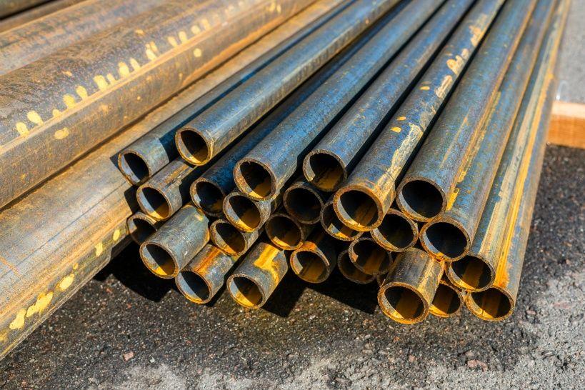 round-metal-pipes-asphalt-close-up.jpg