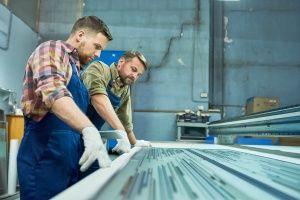 workers-operating-laser-engraving-machine.jpg